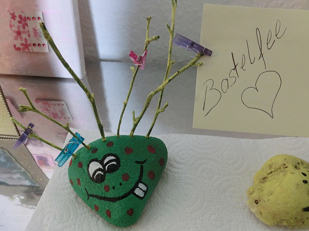 Make stone monster with branches - sticking branches into the holes and decorate